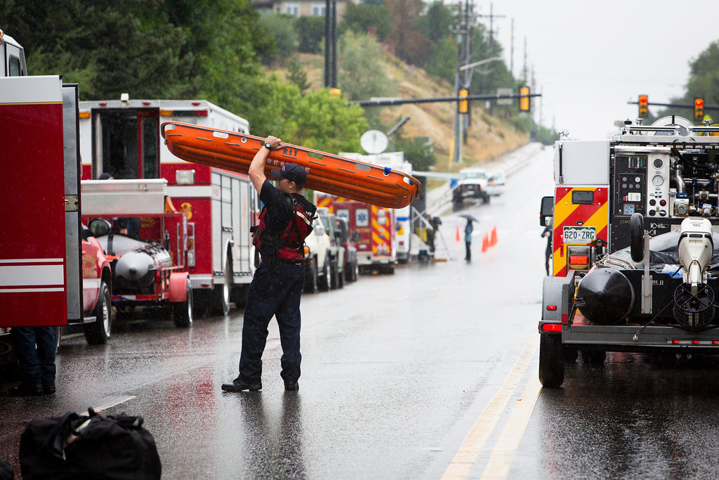 . BOULDER, CO - SEPTEMBER 12: Search and Rescue, the Police and local Fire Departments gather after a fatal car accident on Linden Drive September 12, 2013 in Boulder, Colorado. An estimated 6-10 inches of rain fell in 12-18 hours and more is expected throughout the day. Flash flood sirens warned people to stay away from Boulder Creek and seek higher ground.  (Photo by Dana Romanoff/Getty Images)