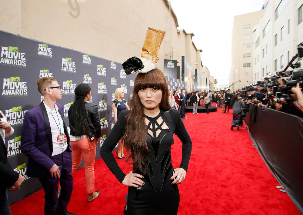 . Actress Hana Mae Lee wears a cigarette butt hat as she arrives at the 2013 MTV Movie Awards in Culver City, California April 14, 2013.   REUTERS/Danny Moloshok