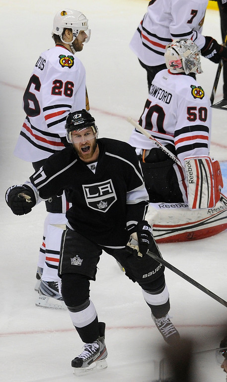 . Kings#77 Jeff Carter celebrates after Kings#26 Slava Voynov scored a goal in the 2nd period. The Kings played the Chicago Blackhawks in the 3rd game of the Western Conference Finals. Los Angeles, CA 6/4/2013(John McCoy/LA Daily News4