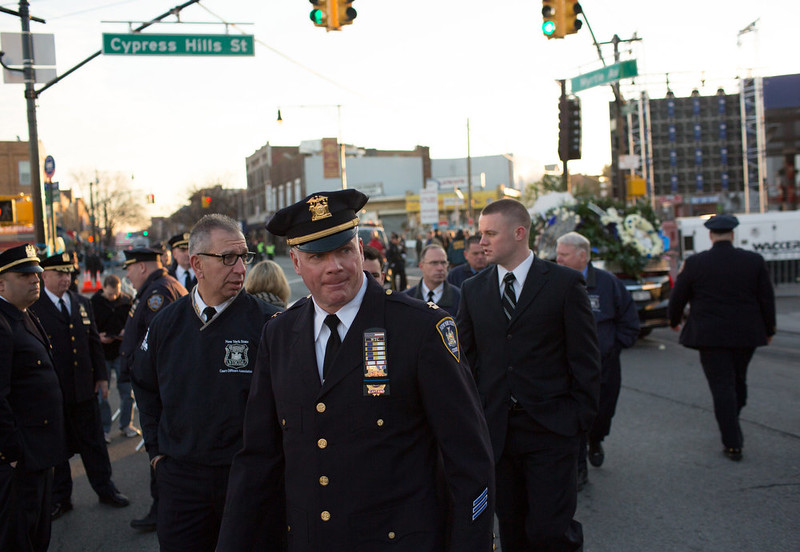 . Officers arrive early for the funeral of slain New York City Police Officer Rafael Ramos, one of two officers murdered while sitting in their patrol car in an ambush in Brooklyn last Saturday afternoon on December 27, 2014 in New York City. Thousands of fellow officers, family, friends and Vice President Joseph Biden are expected at the church in the Glendale neighborhood of Queens for the funeral. (Photo by Kevin Hagen/Getty Images)