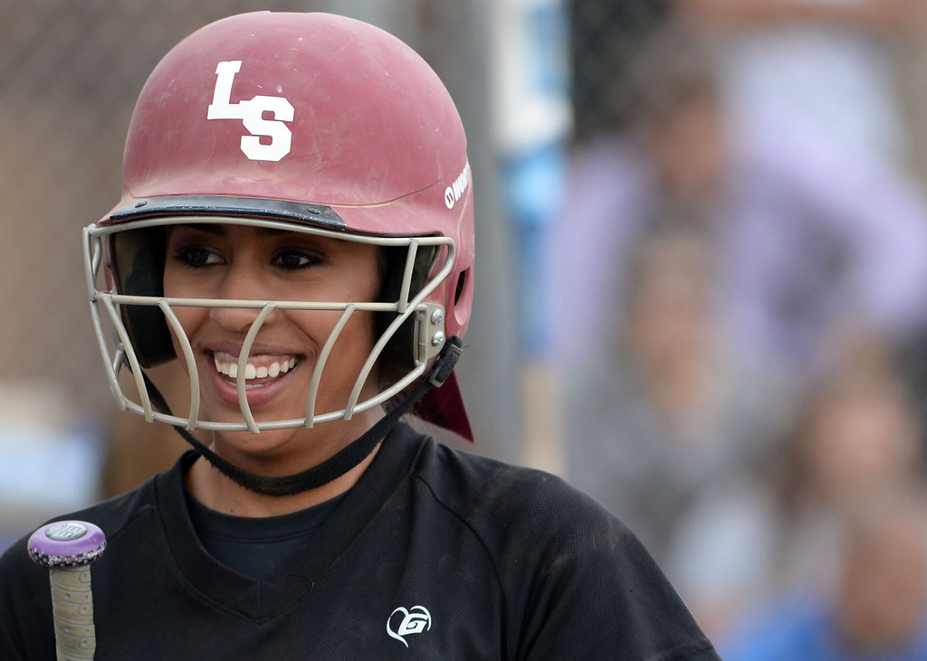 . La Serna\'s Taylor Becerra smiles after scoring on a two RBI single by Danielle Garcielita (not pictured) in the fourth inning of a prep playoff softball game at Bishop Amat High School in La Puente, Calif., on Thursday, May 22, 2014. La Serna won 6-0.   (Keith Birmingham/Pasadena Star-News)
