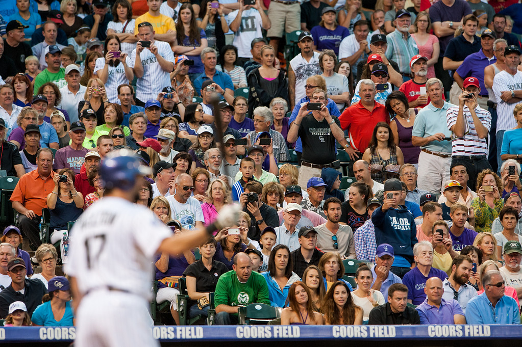 . DENVER, CO - AUGUST 31:  Fans point their cell phone cameras towards home plate as Todd Helton #17 of the Colorado Rockies attempts to reach 2,500 career hits in the second inning of a game against the Cincinnati Reds at Coors Field on August 31, 2013 in Denver, Colorado. The Rockies beat the Reds 9-6. (Photo by Dustin Bradford/Getty Images)