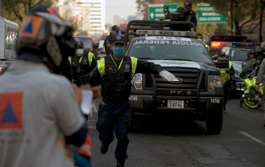 . A Mexican Federal Police truck heads to the skyscraper that houses the headquarters of state-owned Mexican oil giant Pemex, following a blast inside the building in Mexico City on January 31, 2013. An explosion rocked the skyscraper, leaving up to now 14 dead and 100 injured people, according to official sources.   YURI CORTEZ/AFP/Getty Images
