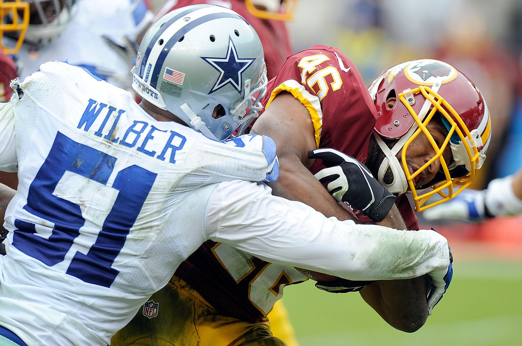 . Alfred Morris #46 of the Washington Redskins is tackled in the second quarter by Kyle Wilber #51 of the Dallas Cowboys at FedExField on December 22, 2013 in Landover, Maryland.  (Photo by Greg Fiume/Getty Images)