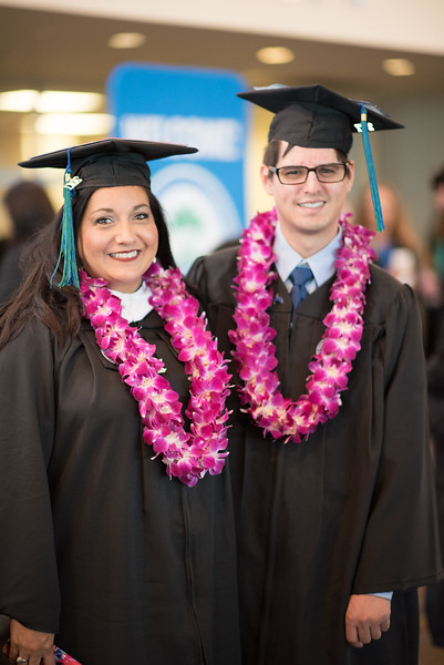 Christina Cisneros (left) and Andrew Cisneros. Over 1,100 graduates received their degrees during two commencement ceremonies held on May 13.