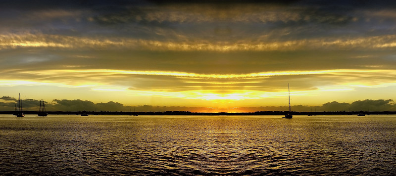 Golden yellow coloured cirrostratus cloudy coastal Sunset Seascape panorama. Australia