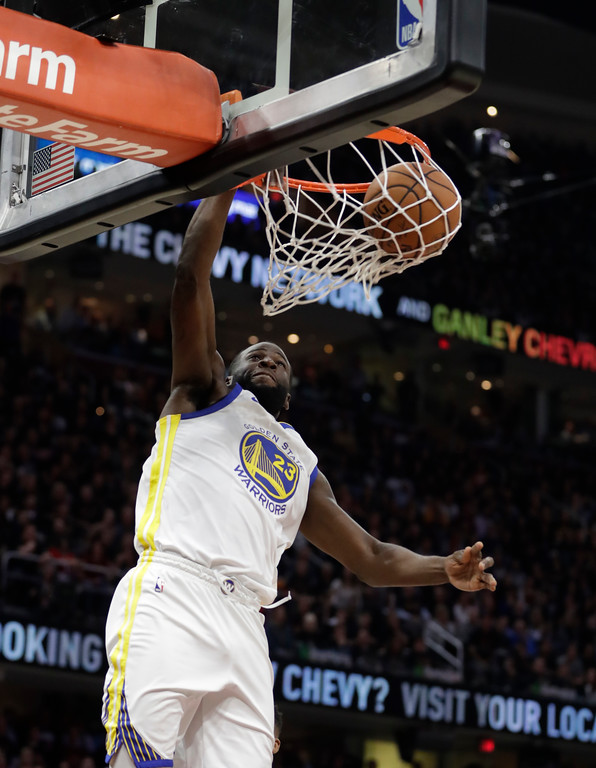 . Golden State Warriors\' Draymond Green dunks in the first half of Game 3 of basketball\'s NBA Finals against the Cleveland Cavaliers, Wednesday, June 6, 2018, in Cleveland. (AP Photo/Tony Dejak)