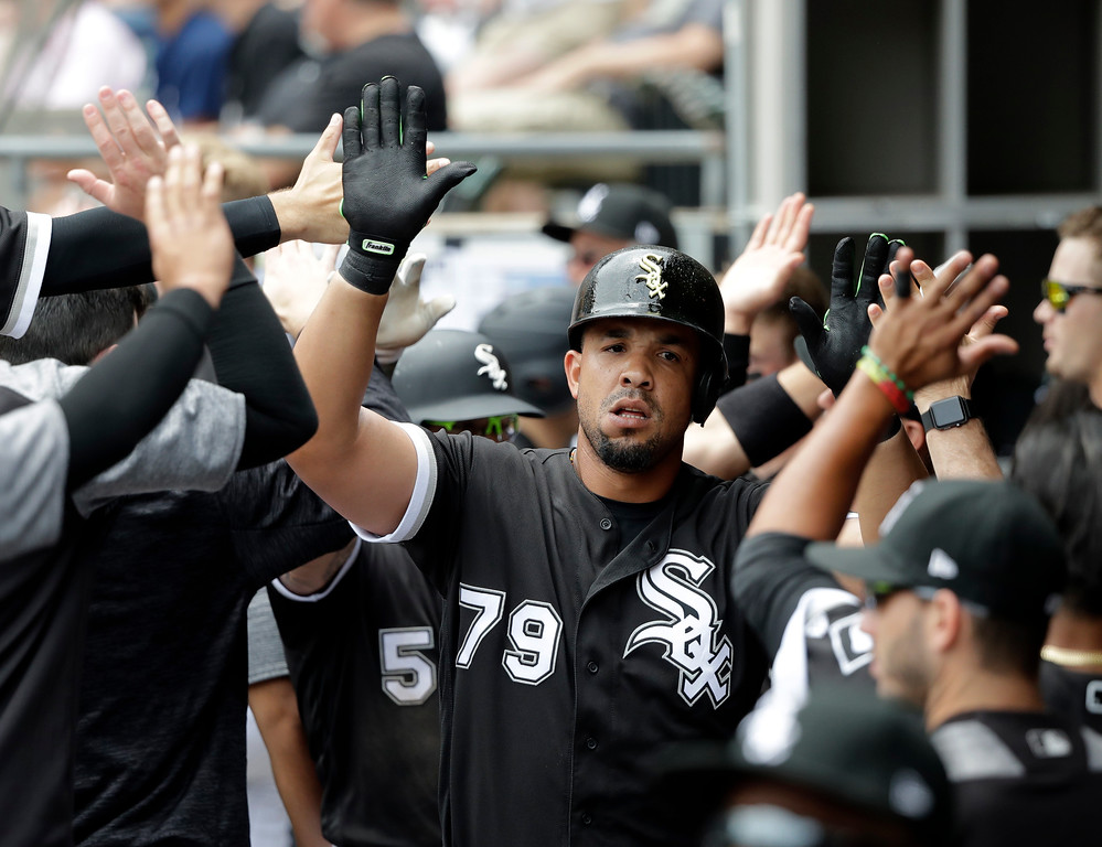 . Chicago White Sox\'s Jose Abreu (79) celebrates in the dugout his two-run home run off Cleveland Indians starting pitcher Mike Clevinger during the first inning of a baseball game Thursday, June 14, 2018, in Chicago. Yolmer Sanchez also scored. (AP Photo/Charles Rex Arbogast)