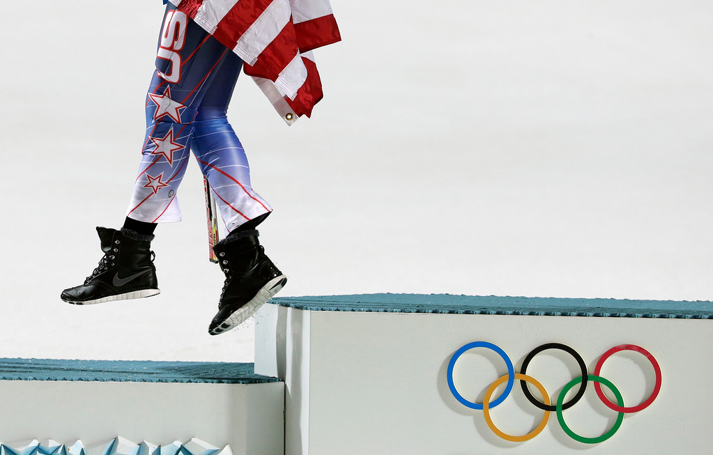 . Women\'s slalom gold medal winner Mikaela Shiffrin of the United States steps off of the podium after a flower ceremony at the Sochi 2014 Winter Olympics, Friday, Feb. 21, 2014, in Krasnaya Polyana, Russia. (AP Photo/Gero Breloer)