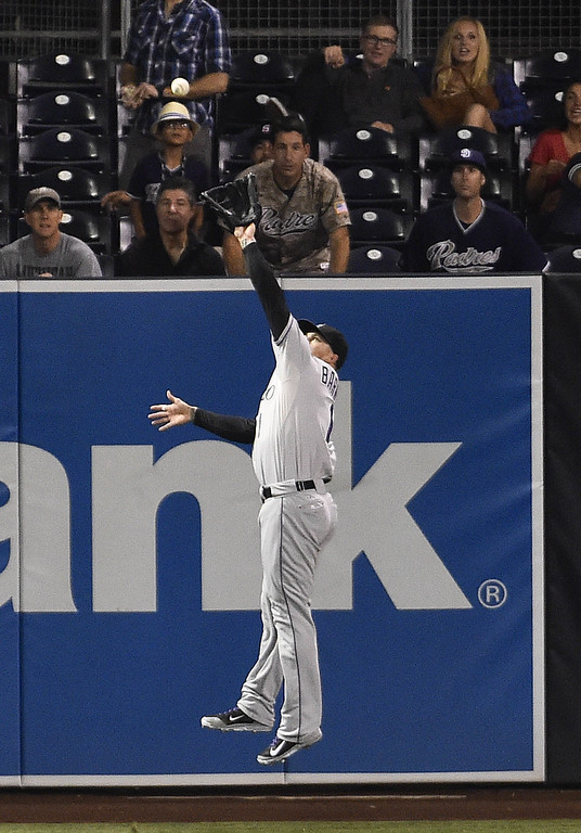 . SAN DIEGO, CA - SEPTEMBER 23:  Brandon Barnes #1 of the Colorado Rockies makes a leaping catch on a ball hit by Tommy Medica #14 of the San Diego Padres during the second inning of a baseball game against the San Diego Padres at Petco Park September, 23, 2014 in San Diego, California.  (Photo by Denis Poroy/Getty Images)