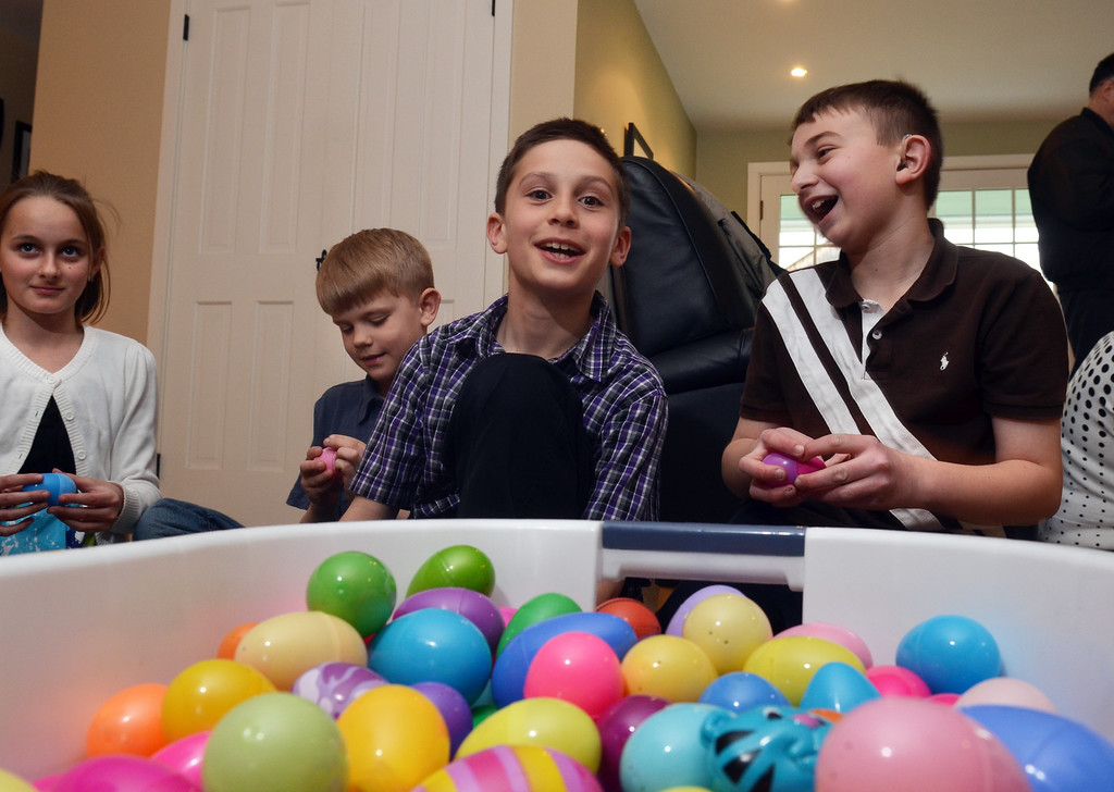 . Peter Zucca, right, shares a laugh with his friend Tyler Bovell while preparing eggs for Easter Egg hunt.   Friday, April 4, 2014.  Photo by Geoff Patton