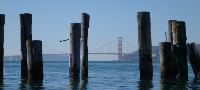 The bridge, windowpaned by the old piers.