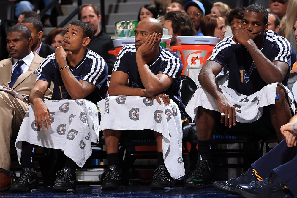 . (L-R) Earl Watson #11, Jamaal Tinsley #6 and Paul Millsap #24 of the Utah Jazz look on from the bench in the final minutes against the Denver Nuggets at the Pepsi Center on January 5, 2013 in Denver, Colorado. The Nuggets defeated the Jazz 110-91. (Photo by Doug Pensinger/Getty Images)