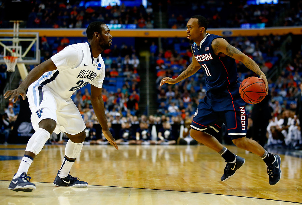 . BUFFALO, NY - MARCH 22: Ryan Boatright #11 of the Connecticut Huskies handles the ball as JayVaughn Pinkston #22 of the Villanova Wildcats defends during the third round of the 2014 NCAA Men\'s Basketball Tournament at the First Niagara Center on March 22, 2014 in Buffalo, New York.  (Photo by Jared Wickerham/Getty Images)