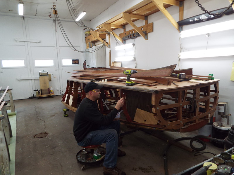 Applying epoxy to the batten slots so we can install the new starboard side battens.