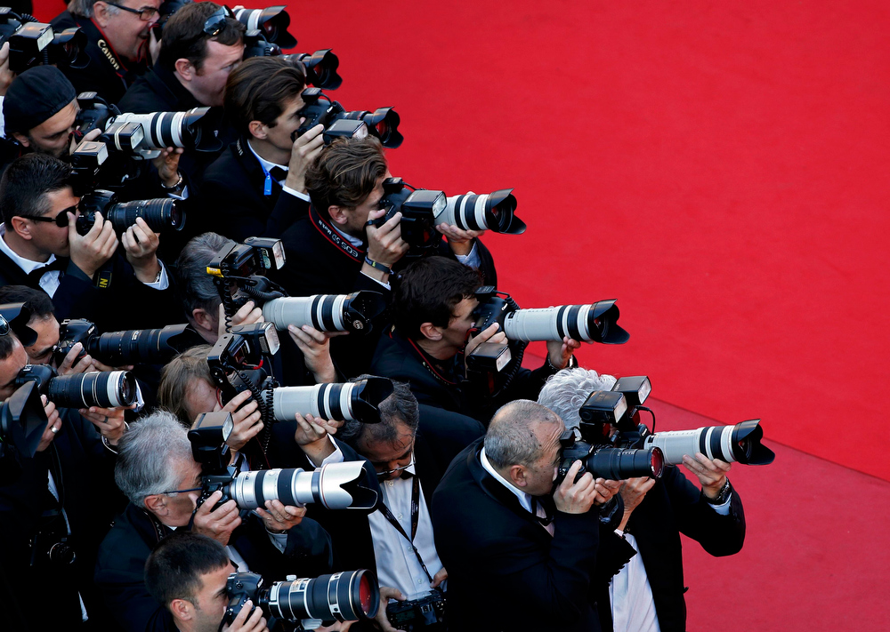 ". Photographers work on the red carpet during arrivals for the screening of the film ""Behind the Candelabra\"" in competition during the 66th Cannes Film Festival in Cannes May 21, 2013.            REUTERS/Eric Gaillard"