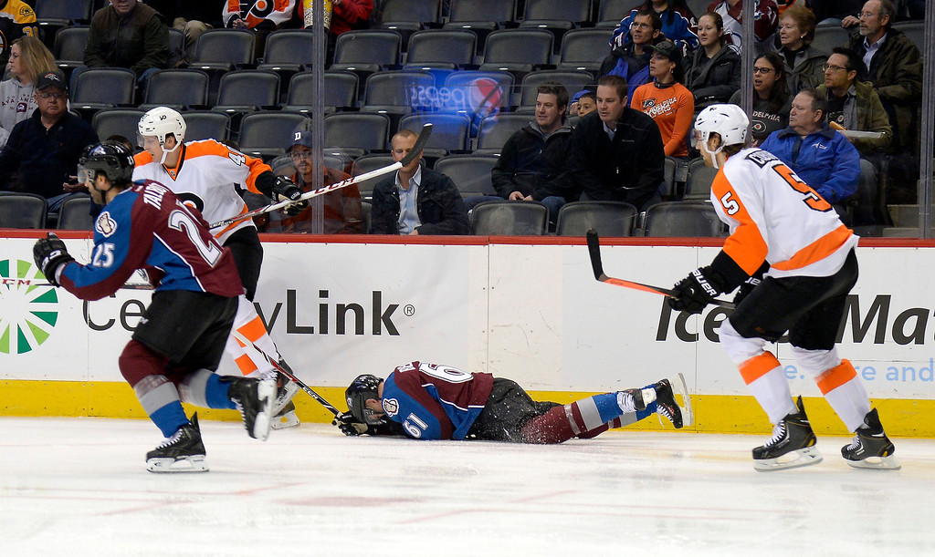 . Colorado Avalanche defenseman Andre Benoit (61) lays on the ice after getting hit in the face during their game against the Philadelphia Flyers in the first period January 2, 2014 at Pepsi Center. (Photo by John Leyba/The Denver Post)