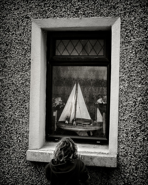 Boy and a boat.