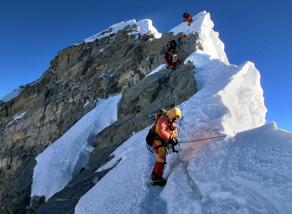 . Climbers navigate the knife-edge ridge just below the Hillary Step on their way to the summit of Mount Everest, in the Khumbu region of the Nepal Himalayas on May 18, 2013. Sixty years ago Wednesday, Sir Edmund Hillary and climbing partner Tenzing Norgay were the first to set foot on the summit of Mount Everest, the highest point on earth on May 29, 1953. (AP Photo/Alpenglow Expeditions, Adrian Ballinger)