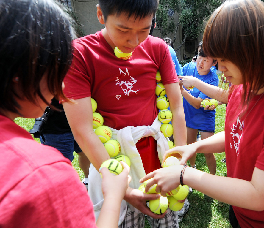 . A contest to hold the most tennis balls without dropping one for Kindom Hearts Stack during Ditch Day. A fun-filled day of antics and escapades, Ditch Day is one of Caltech�s oldest traditions � a cross between Animal House and a science fair! Friday, May 24, 2013. Caltech seniors ditch their classes while underclassmen devote their entire day to quirky pranks and attempting to solve elaborate puzzles, mazes, quests, and other challenging hijinks that seniors have devised and left behind for them.This year�s activities include a laser maze, sledgehammer brick building demolition, shopping cart race, sumo tournament, roof rappelling, hovercraft human bowling, teleportation and time-travel puzzles, and much more.(SGVN/Photo by Walt Mancini)