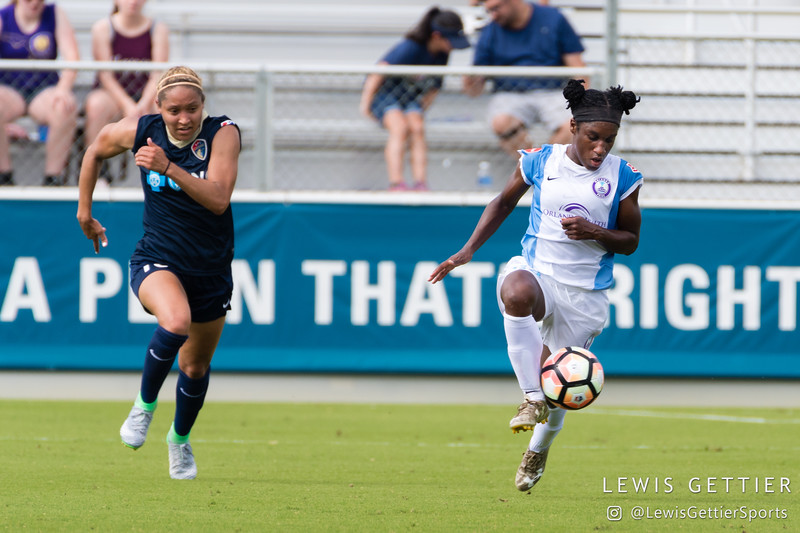 Jasmyne Spencer (23) and Jaelene Hinkle (15) during a match between the NC Courage and the Orlando Pride in Cary, NC in Week 3 of the 2017 NWSL season. Photo by Lewis Gettier.
