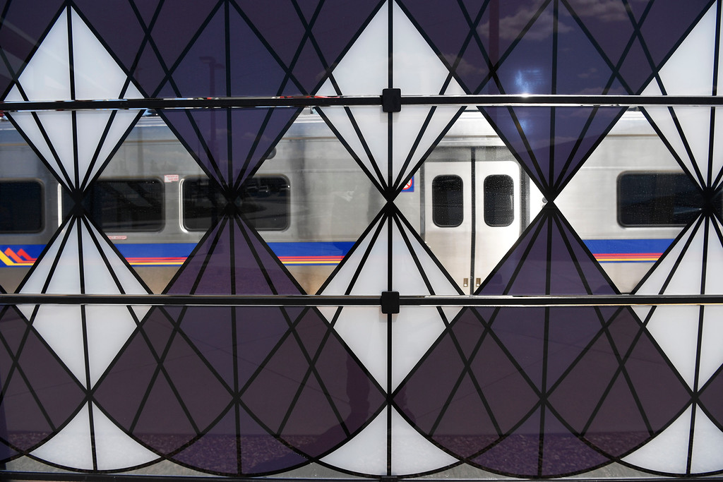 . DENVER, CO - May 03: Glass panel windscreen artwork by Sandra Fettingis entitled �Tumble Weeds Really Do Exist,� graces five RTD University of Colorado A Line stations as part of the RTD\'s ART-N-TRANSIT program May 03, 2016. (Photo by Andy Cross/The Denver Post)