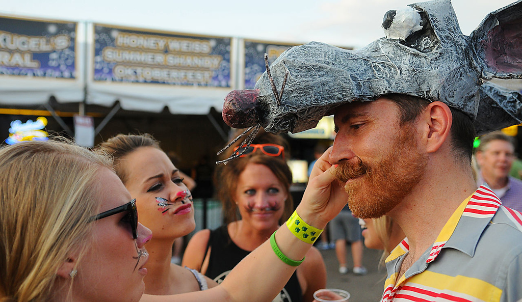 """. Kevin Kirsch, from Minneapolis, came sporting a mouse figure on his hat to the 2013 Internet Cat Video Festival presented by Walker Art Center at the Minnesota State Fair Grandstand, Wednesday, August 28, 2013 in Falcon Heights. \""""Some of my best friends are cats,\"""" said Kirsch as three women dress as cats \""""played with him\"""". (Pioneer Press: John Autey)"""