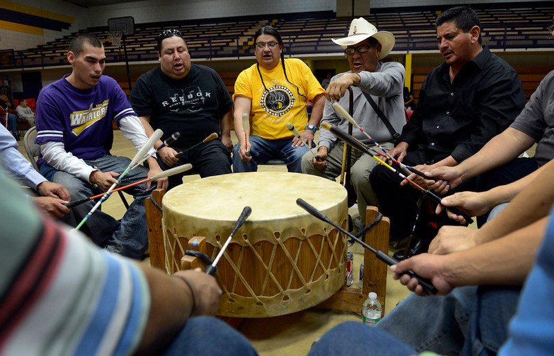 . A group of American Indians lead by Head Singer, Jimmy Reeder, center (yellow shirt) drum and sing ceremonial songs during the 22nd annual Sand Creek Descendants Gathering in Anadarko Oklahoma  Saturday, December 1st, 2012. Nearly 100 descendants of the Sand Creek Massacre gathered at the Anadarko High School gym for traditional Gourd dancing, food and other activities and also to get updates on legal action towards the U.S. for the massacre which left over 150 Cheyenne and Arapaho Indians dead in southeast Colorado November 29th, 1864. The Denver Post/ Andy Cross