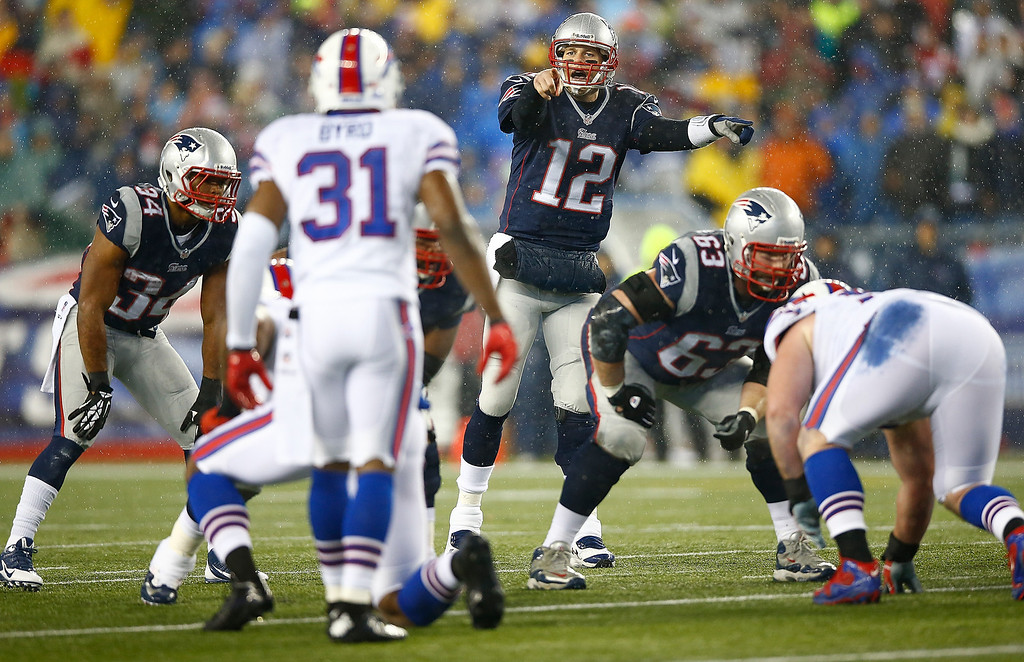 . Tom Brady #12 of the New England Patriots stands behind center in the first quarter against the Buffalo Bills during the game at Gillette Stadium on December 29, 2013 in Foxboro, Massachusetts.  (Photo by Jared Wickerham/Getty Images)