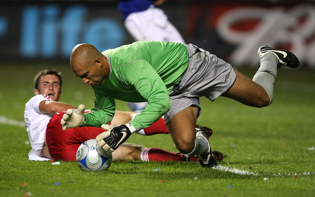 . Tim Howard #1 of Everton FC dives for the ball to make a save on a shot by Steven King #33 of the Chicago Fire (on ground) during an international friendly match on July 30, 2008 at Toyota Park in Bridgeview, Illinois. The Fire defeated Everton FC 2-0. (Photo by Jonathan Daniel/Getty Images)