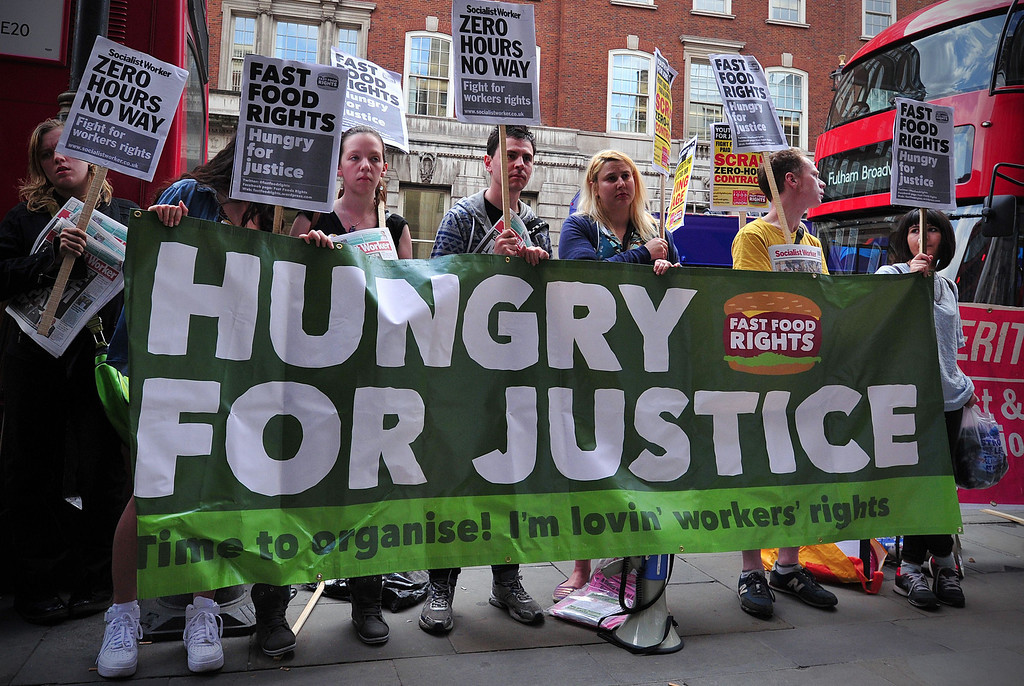 . Fast food workers protest for higher wages and rights outside a branch of McDonalds in central London on May 15, 2014. Fast-food restaurant employees held a global day of protest and strike action in a push for better pay and conditions. AFP PHOTO / CARL COURT/AFP/Getty Images