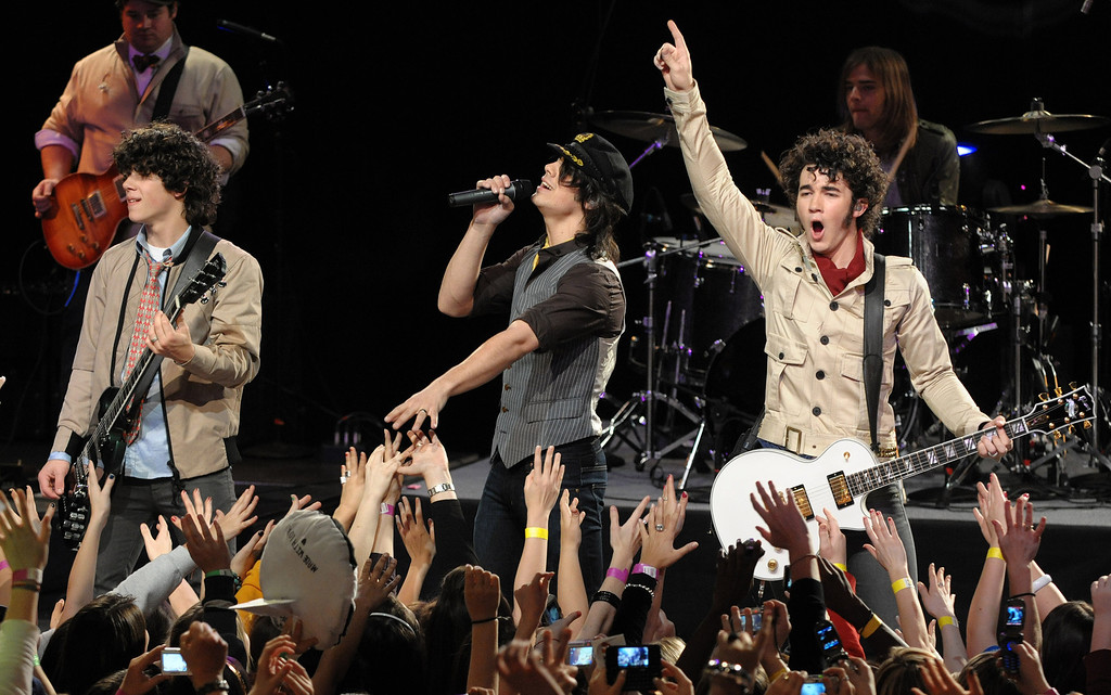 . Musicians Nick Jonas, Joe Jonas and Kevin Jonas, from left, of The Jonas Brothers perform on the CBS Early Show at the Hard Rock Cafe in Times Square, Friday, March 21, 2008, in New York. (AP Photo/Peter Kramer)