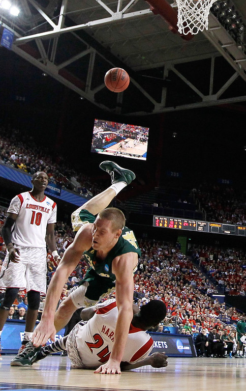 . LEXINGTON, KY - MARCH 23:  Colton Iverson #45 of the Colorado State Rams goes up for a dunk and is called for an offensive foul against Montrezl Harrell #24 of the Louisville Cardinals in the first half during the third round of the 2013 NCAA Men\'s Basketball Tournament at Rupp Arena on March 23, 2013 in Lexington, Kentucky.  (Photo by Kevin C. Cox/Getty Images)