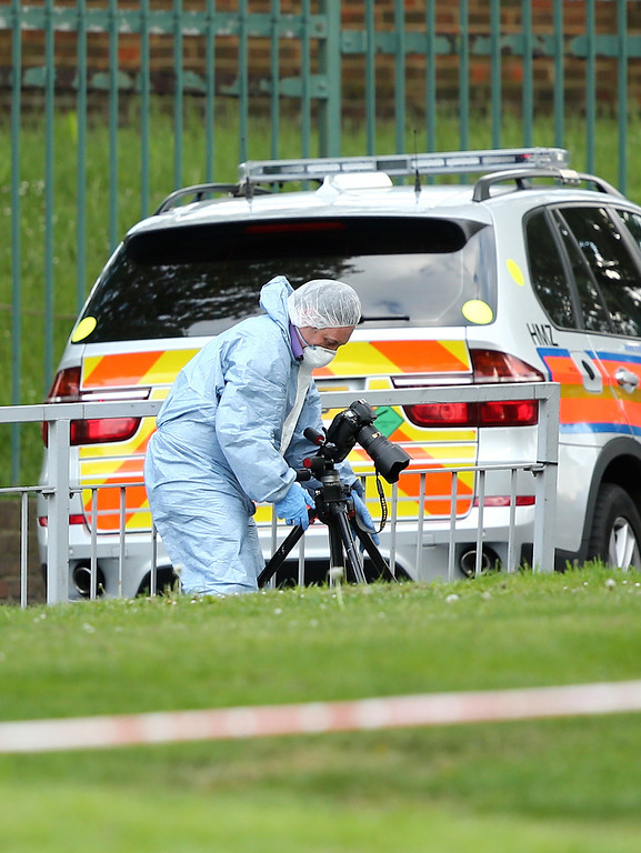 . Scenes of Crime Officers at the scene in Woolwich following a major incident in which a man was killed, on May 22, 2013 in London, England.  (Photo by Dan Kitwood/Getty Images)