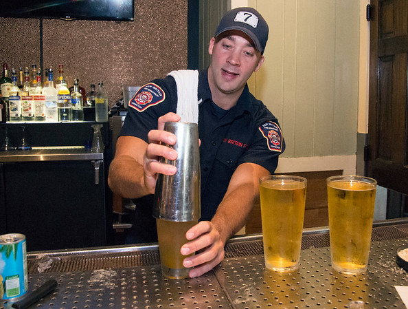 09/25/19 Wesley Bunnell | StaffrrTip a Firefighter took pace at Chili's in New Britain on Wednesday night. The event raised money for the city 's partnership with the community foundation regarding the new disaster relief program. Lt. Tim Cyr mixes drinks for customers.