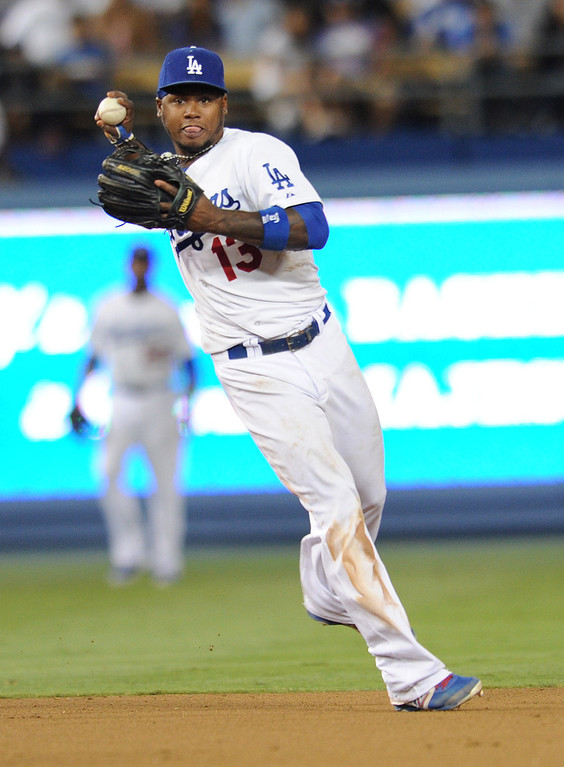 . Hanley Ramirez makes an off balance throw to first to catch a runner. The Cubs defeated the Dodgers 3-2 in a game at Dodger Stadium. Los Angeles, CA. 8/24/2013(John McCoy/LA Daily News)