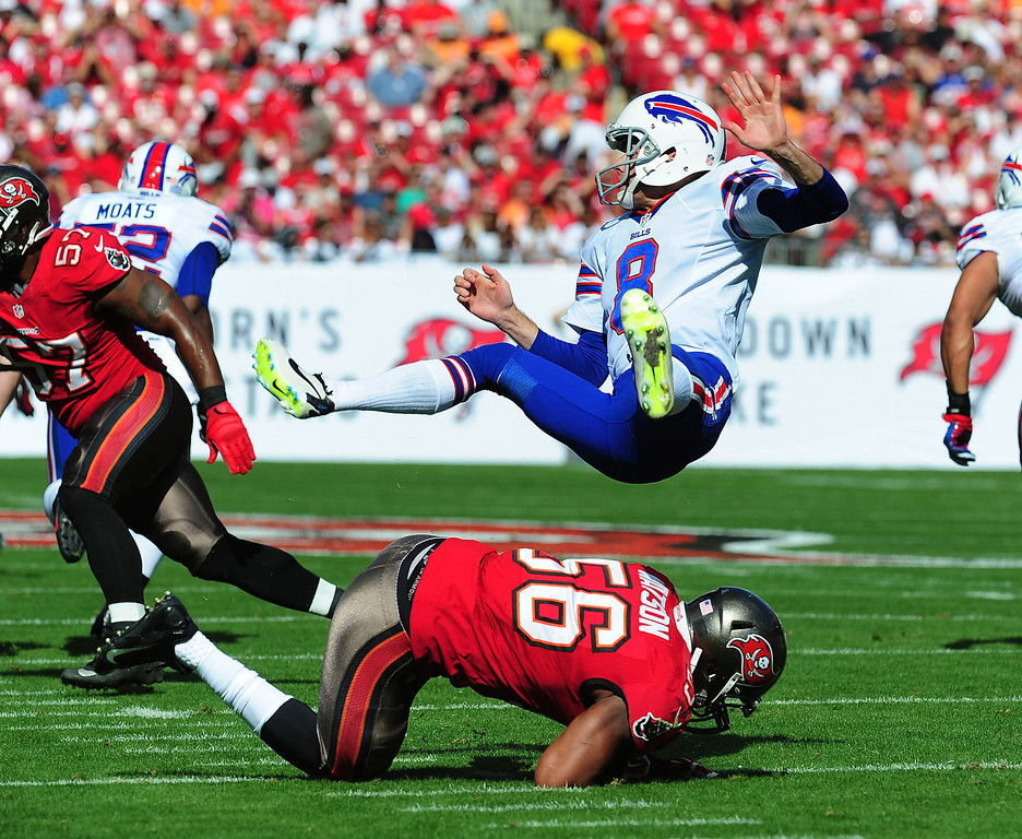 . Punter Brian Moorman #8 of the Buffalo Bills is upended by Dekoda Watson #56 of the Tampa Bay Buccaneers at Raymond James Stadium on December 8 2013 in Tampa, Florida. (Photo by Scott Cunningham/Getty Images)