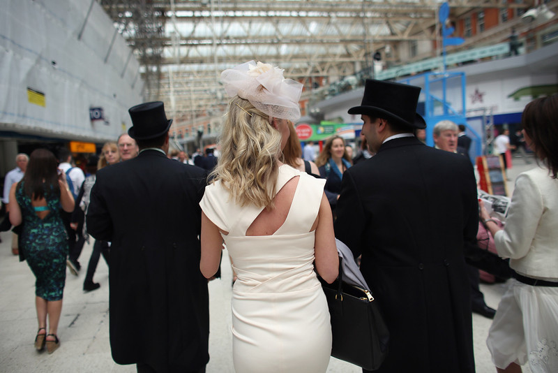 . Racegoers travel by train from Waterloo station to Ascot racecourse to attend Royal Ascot on June 20, 2013 in London, England. The \'Royal Ascot\' horse race meeting runs from June 18, 2013 until June 22, 2013 and has taken place since 1711. The racecourse is expected to welcome around 280,000 racegoers over the five days, including Her Majesty The Queen and other members of the Royal Family.  (Photo by Oli Scarff/Getty Images)