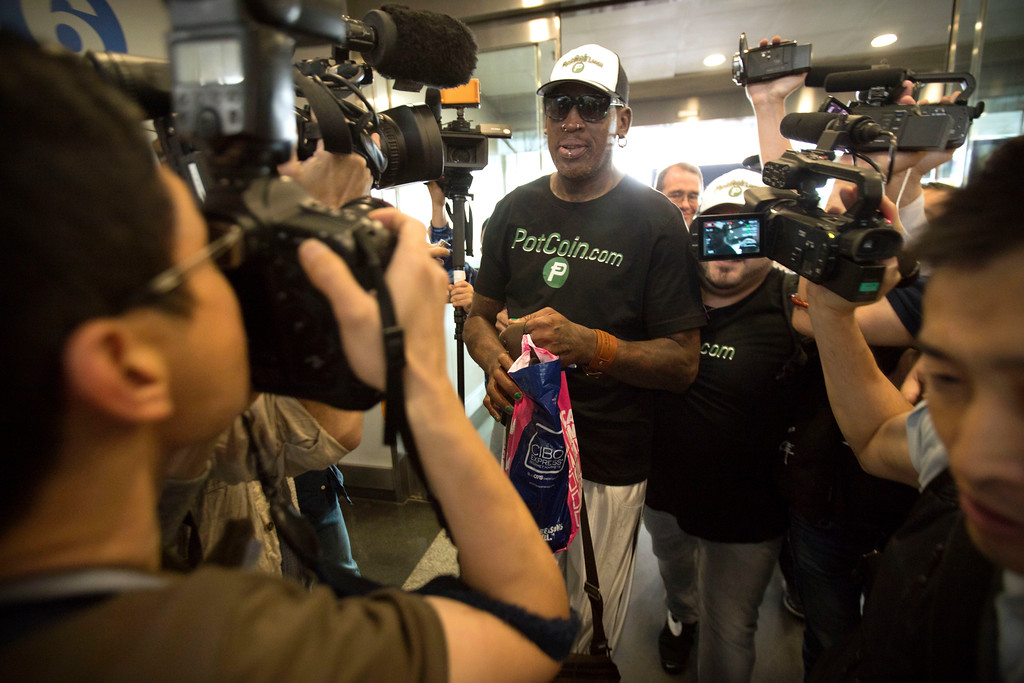 . Former NBA basketball player Dennis Rodman, center, arrives at Beijing Capital International Airport in Beijing, Tuesday, June 13, 2017. North Korea is expecting another visit by Rodman on Tuesday in what would be his first to the country since President Donald Trump took office. (AP Photo/Mark Schiefelbein)