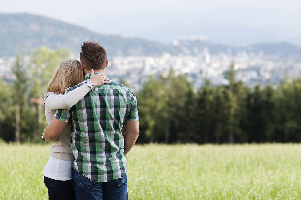 //www.dreamstime.com/stock-photo-happy-romantic-couple-standing-arm-arm-their-backs-to-camera-field-looking-out-over-countryside-to-distant-image39313770