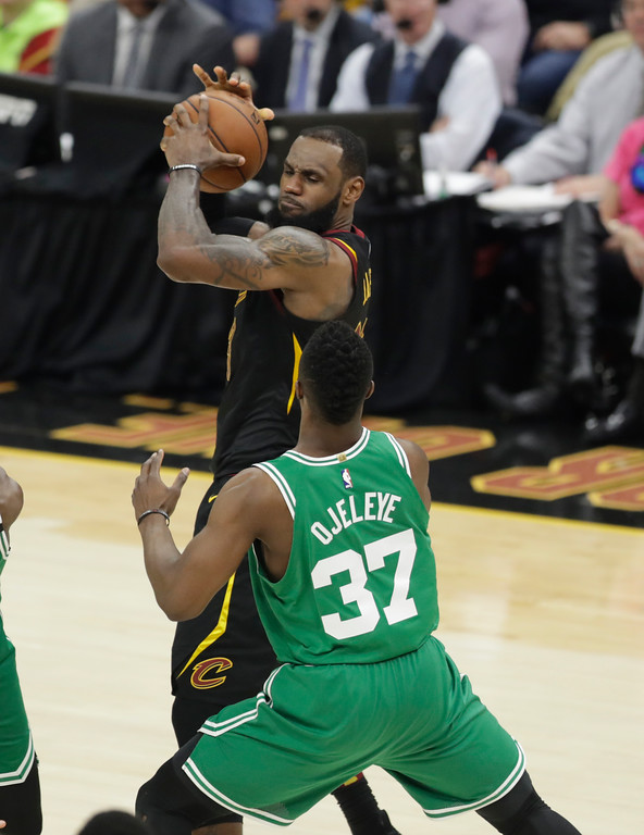 . Cleveland Cavaliers\' LeBron James, top, protects the ball from Boston Celtics\' Semi Ojeleye (37) in the second half of Game 3 of the NBA basketball Eastern Conference finals, Saturday, May 19, 2018, in Cleveland. (AP Photo/Tony Dejak)