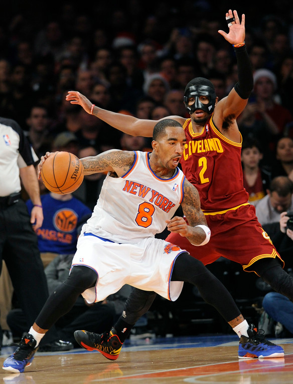 . New York Knicks\' J. R. Smith, left, makes a move on Cleveland Cavaliers\' Kyrie Irving during the fourth quarter of an NBA basketball game on Saturday, Dec. 15, 2012, at Madison Square Garden in New York. The Knicks defeated the Cavaliers 103-102. (AP Photo/Bill Kostroun)