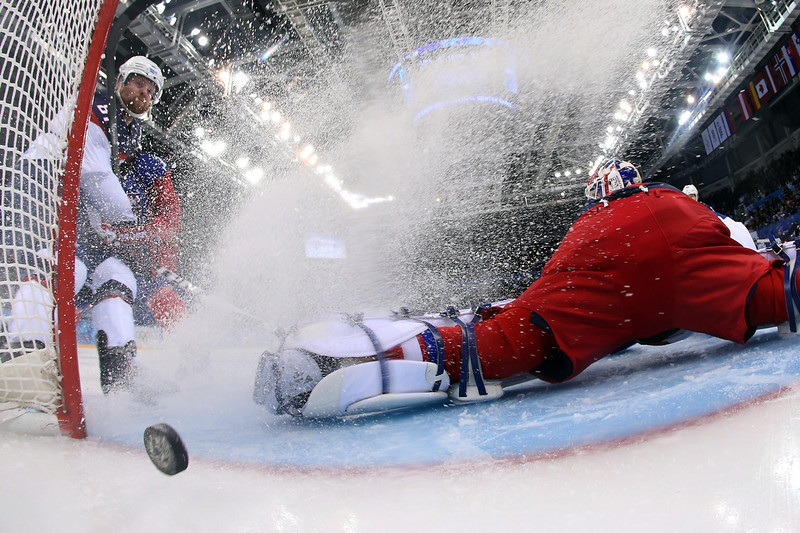 . US Phil Kessel (L) scores his team\'s fifth goal during the Men\'s Ice Hockey Quarterfinals match between the USA and the Czech Republic at the Shayba Arena during the Sochi Winter Olympics on February 19, 2014.  (Martin Rose/AFP/Getty Images)