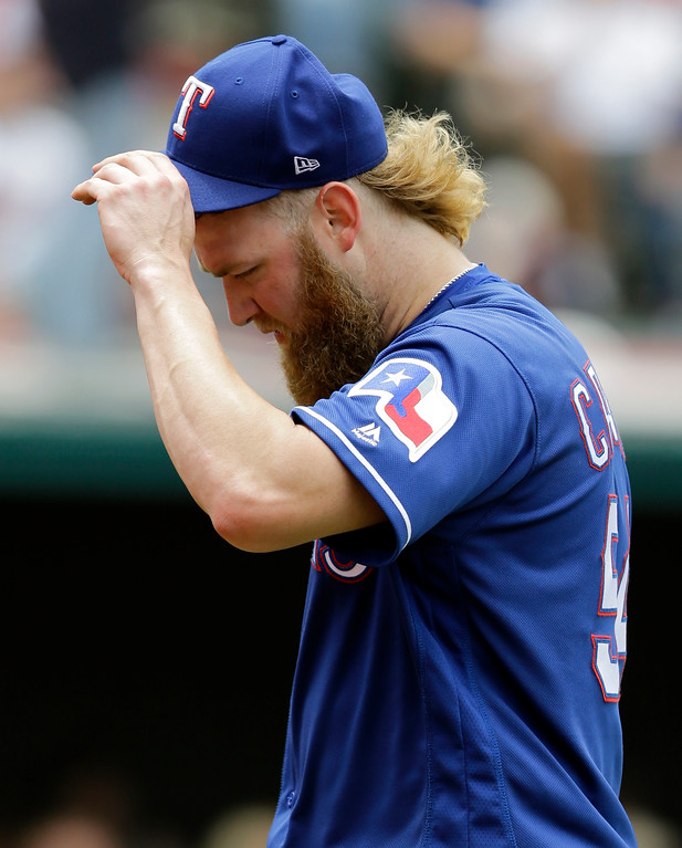 . Texas Rangers starting pitcher Andrew Cashner walks to the dugout in the sixth inning of a baseball game against the Cleveland Indians, Thursday, June 29, 2017, in Cleveland. (AP Photo/Tony Dejak)