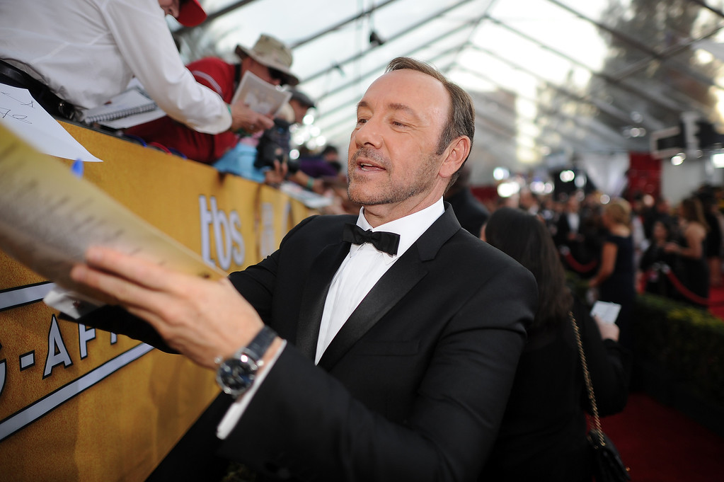. Kevin Spacey signs autographs on the red carpet at the 20th Annual Screen Actors Guild Awards  at the Shrine Auditorium in Los Angeles, California on Saturday January 18, 2014 (Photo by Hans Gutknecht / Los Angeles Daily News)