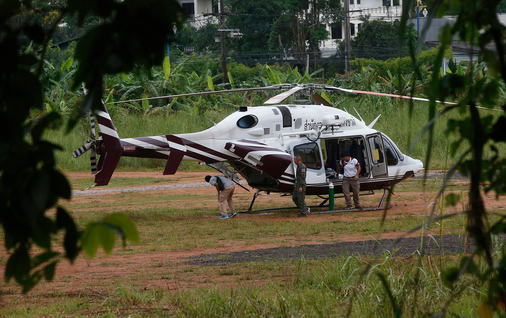 . A helicopter waits near the cave for more evacuations of the boys and their soccer coach who have been trapped since June 23, in Mae Sai, Chiang Rai province, northern Thailand Monday, July 9, 2018. Thailand\'s interior minister says the same divers who took part in Sunday\'s rescue of four boys trapped in a flooded cave will also conduct the next operation as they know the cave conditions and what to do. (AP Photo/Sakchai Lalit)