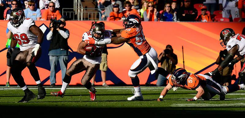 . Denver Broncos outside linebacker Von Miller #58 chases down Tampa Bay Buccaneers defensive back Myron Lewis #23.  Lewis gained three yards.  The Denver Broncos vs The Tampa Bay Buccaneers at Sports Authority Field Sunday December 2, 2012. Joe Amon, The Denver Post