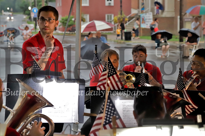 Under a tent and with spectators huddled beneath umbrellas the Allegheny Brass Band played on for Harmony's Fourth of July Celebration Thursday. Seb Foltz/Butler Eagle