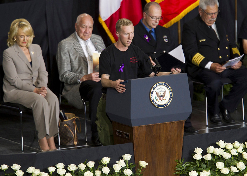 . Brendan McDonough recites the Hotshots Prayer during a memorial service at Tim\'s Toyota Center in Prescott Valley, Arizona July 9, 2013.    REUTERS/Michael Chow/Pool