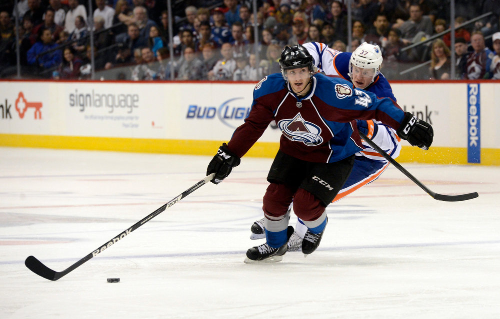 . DENVER, CO. - FEBRUARY 2ND: Michael Sgarbossa, Colorado Avalanche, left, advances the puck Lennart Petrell, Edmonton Oilers in the third period at the Pepsi Center in Denver Colorado, February 2nd, 2013.  (Photo By Andy Cross / The Denver Post)